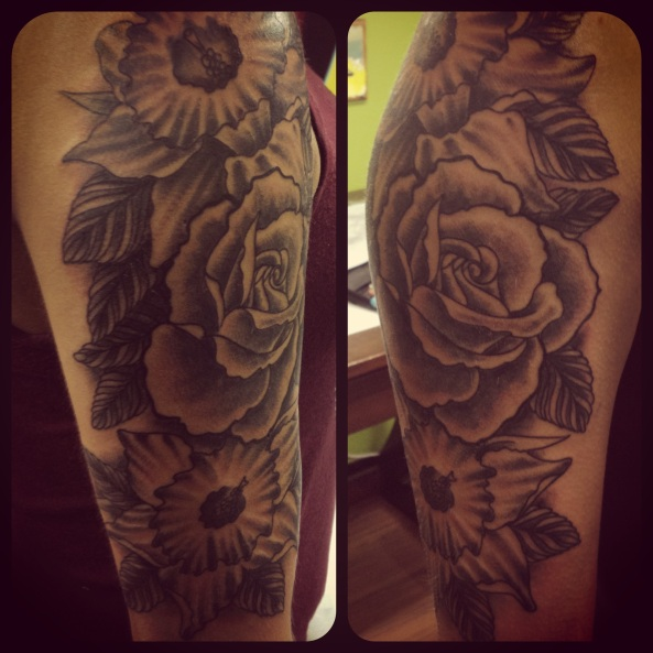 Some black and grey flowers, done at Classic Tattoo in Red Deer.